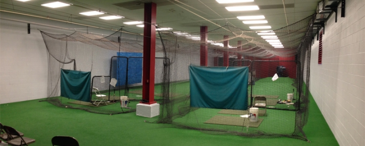 The batting cages now feature red columns and a much softer off-white paint along the sides.
