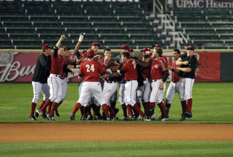 The Curve celebrate after a walk-off single by Jacob Stallings that capped a seven-run comeback win over the Baysox in Game 1 of the Western Division Series (Photo: Mark Olson / MiLB)