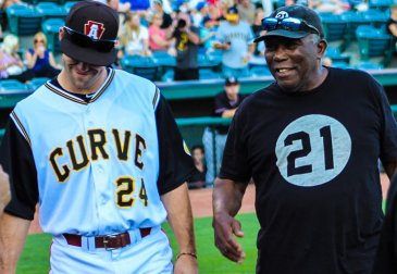 Jonathan Schwind talking with former Pirates catcher Manny Sanguillen on Tribute to Roberto Clemente Night at PNG Field (Photo: Trey Wilson/Altoona Curve)